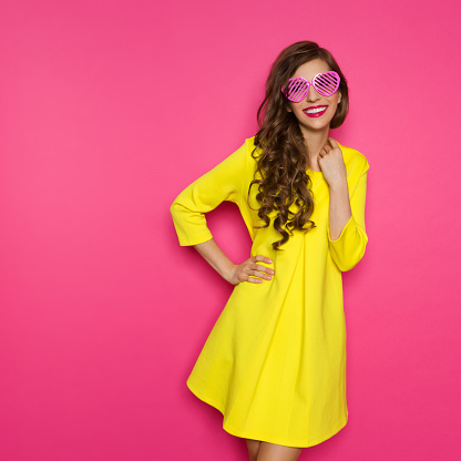 Cheerful Young Woman In Pink Sunglasses