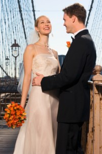 Bride and groom on Brooklyn Bridge, New York City, NY
