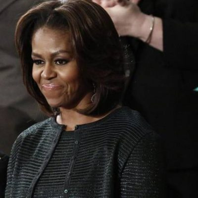 MICHELLE OBAMA IN DARK GREEN